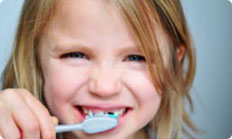 image of child teeth cleaning at hassey do duy dental associates